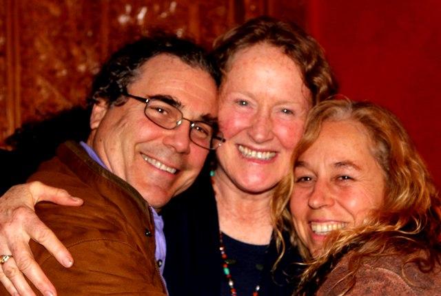 Ray, Mary and Tara hugging and smiling.